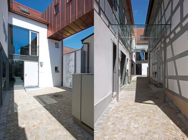 Der Neubau setzt sich in konsequent moderner Fassadensprache von den Altbauten ab. Geburtshaus und Nachbargebäude sind durch eine filigrane Stahl-Glas-Überdachung verbunden