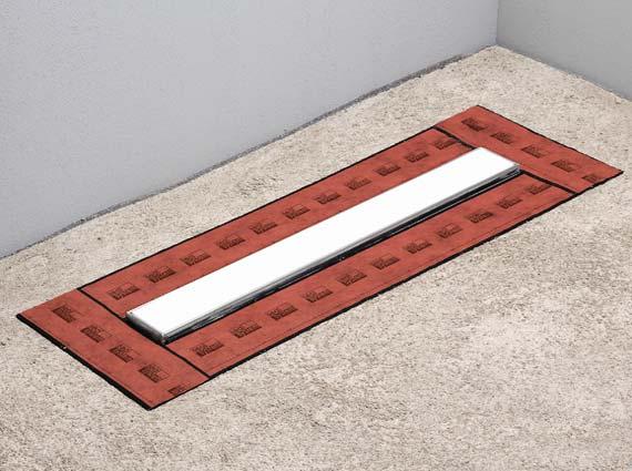 Überlappende Seal System Dichtbänder vor dem Auftragen der Verbundabdichtung. Sie wirken als verbindendes Element zwischen Verbundabdichtung und der Duschrinne.