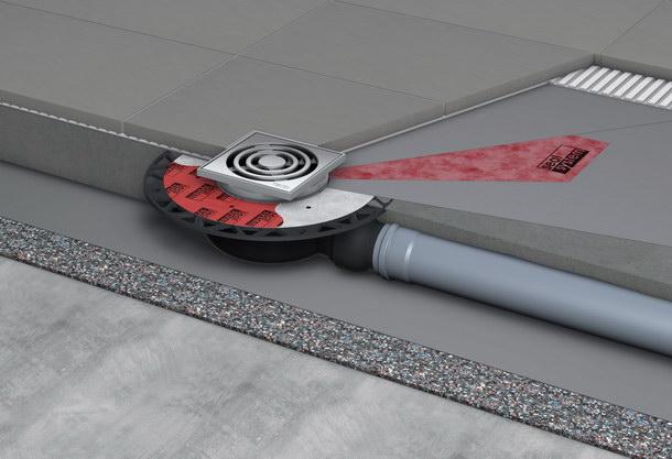Zertifizierter Fußbodenaufbau mit einem Punktablauf mit »Seal System« Dichtmanschette. Sie dichtet im Verbund mit den beiden Dichtschlämme-Aufträgen den Bereich um den Edelstahlflansch der Rinne sicher ab.