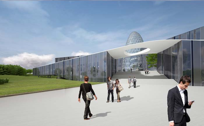 Der zukunftsweisende Bürokomplex mit einer Gesamtnutzfläche von 8.800 m² steht inmitten einer von Grünflächen umrahmten Landschaft. Ein breiter Weg führt zum Vordergebäude sowie zu einer Treppe, über die man das dahinter liegende Hauptgebäude erreicht. Bild: Bayer Material Science AG