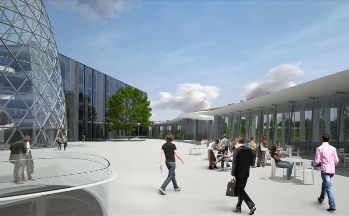Vorder- und Hauptgebäude umschließen die in der Mitte liegende Piazza, die auch vom Restaurant zugänglich ist und Sitzmöglichkeiten im Freien bietet. Bild: Bayer Material Science AG